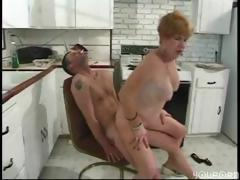 Busty mature redhead blows..