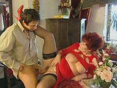 Red-haired granny spreads..