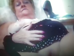 Hot granny teases on webcam.